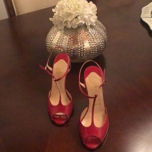 Christian Louboutin pink patent peep toe heels
